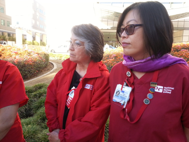 UCLA nurses Lucia Brandt, left, and Fong Chu, right, at the demonstration at the Ronald Reagan UCLA Medical Center.