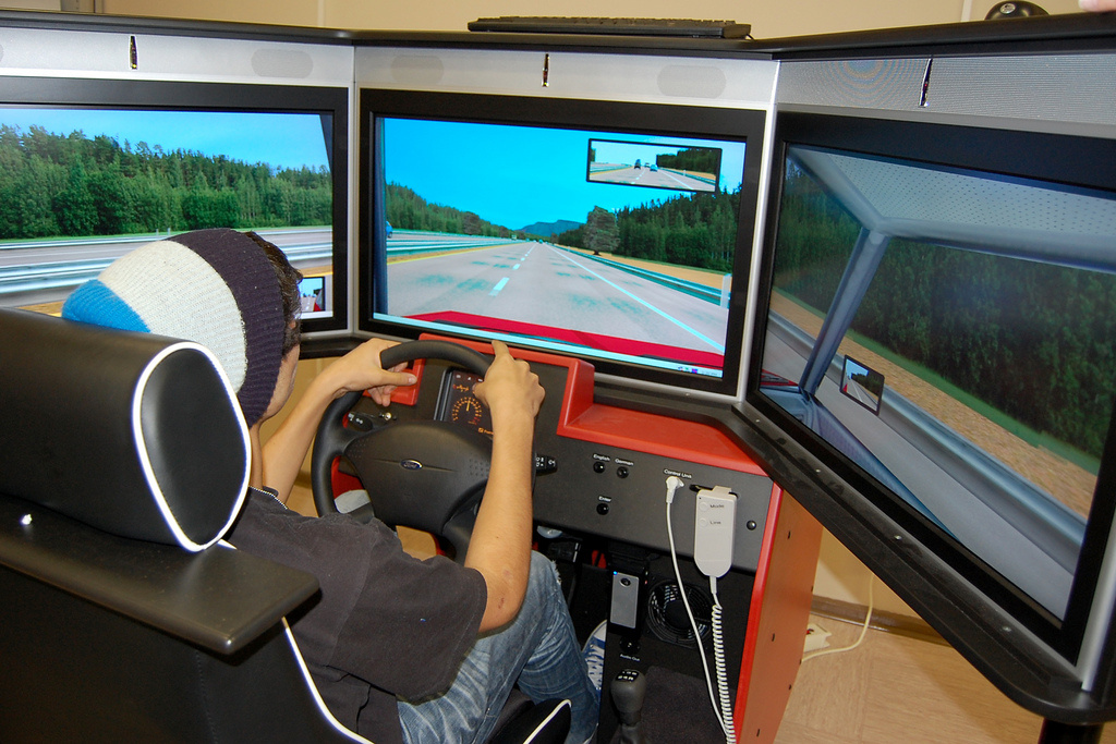 A teenager in a driving simulator during a driver's education class.
