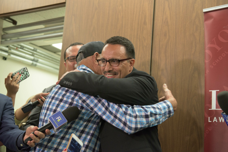 A newly-freed Marco Contreras hugs his father.