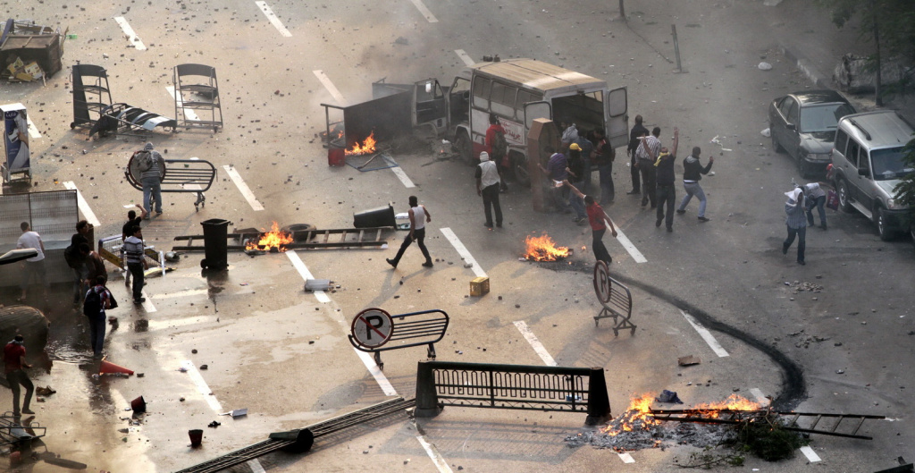 Egyptian Muslim brotherhood and supporters of ousted president Mohamed Morsi block the road during clashes with riot police along Ramsis street in downtown Cairo, on Oct. 6, 2013.