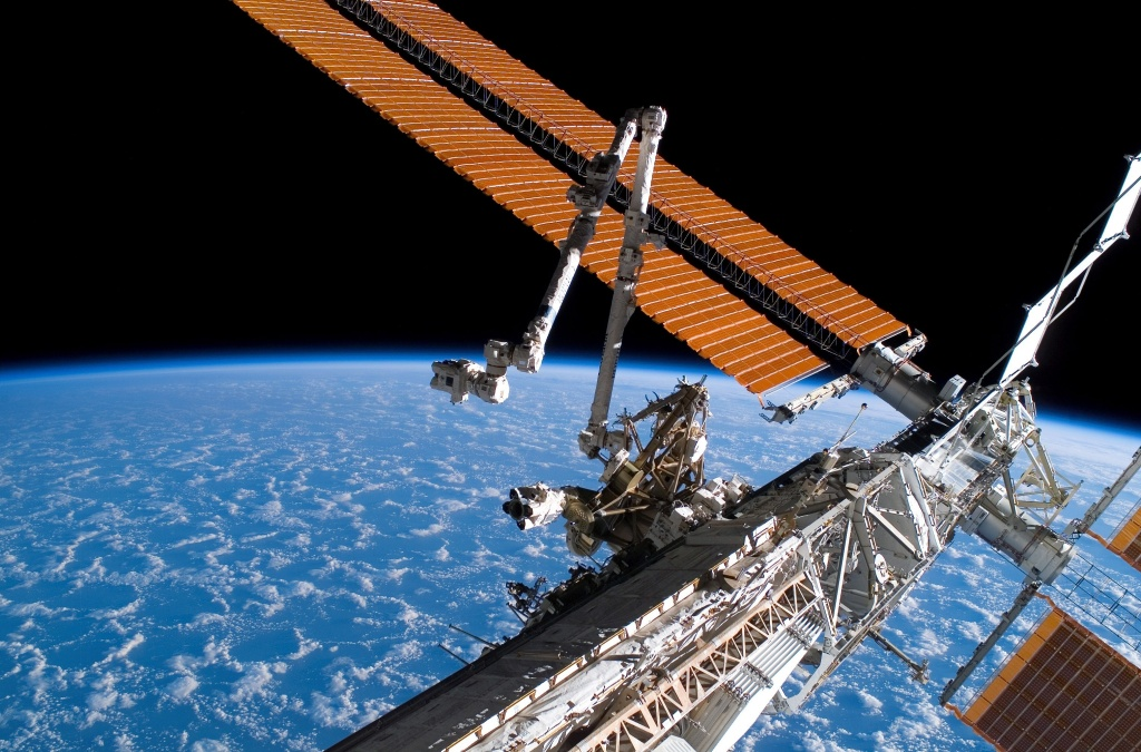 IN SPACE - AUGUST 11:  In this handout photo provided by NASA, the Canadarm2 (center) and solar array panel wings on the International Space Station are extended.