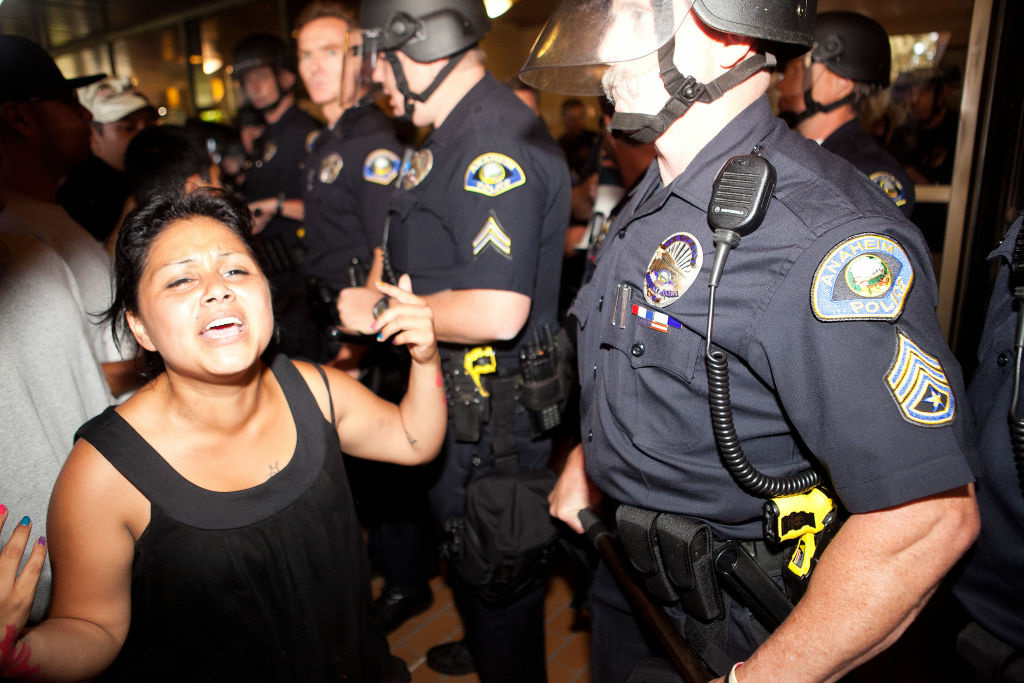 Protesters clashed in July with police at Anaheim City Hall to show their outrage over the shooting death of Manuel Diaz.