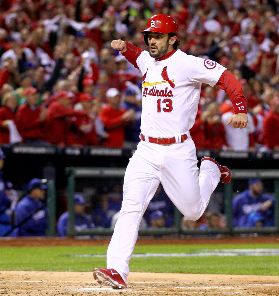 Matt Carpenter of the St. Louis Cardinals as he scored his team's first run Friday night. The Cards would go on to beat the Los Angeles Dodgers 9-0 and advance to the World Series.