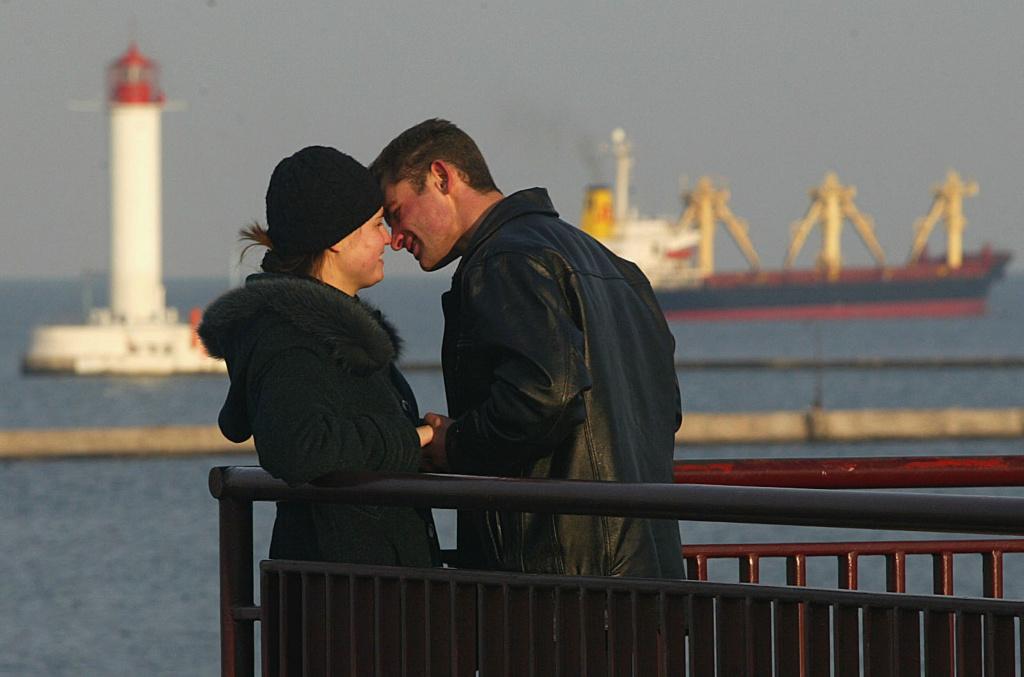A couple share a romantic moment.