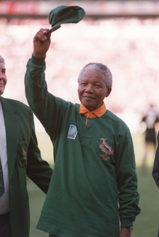 South African National Congress (ANC) President Nelson Mandela on March 15, 1994 in Mmabatho gives a clenched fist to supporters upon his arrival for his first election rally for April 27 general elections.