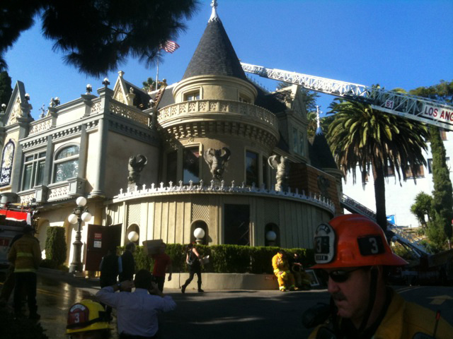 Firefighters at the Magic Castle after it caught fire Monday afternoon Oct. 31, 2011.