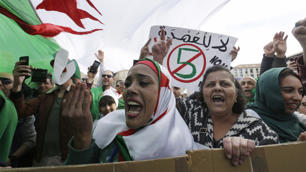 Demonstrators stage a protest against President Abdelaziz Bouteflika's bid for a fifth term, in Marseille, France.