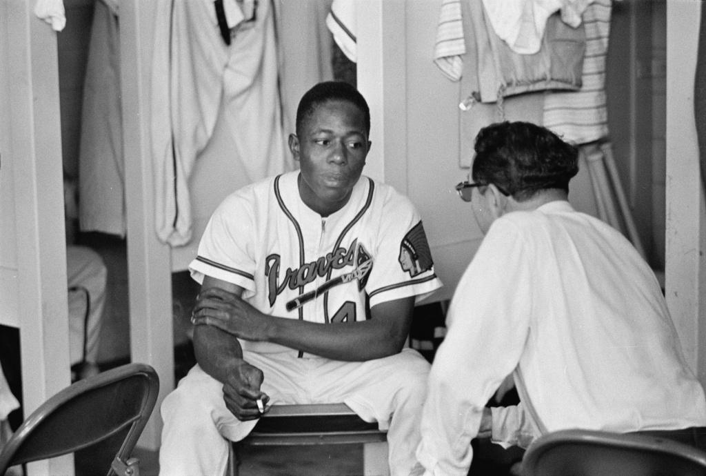 Hank Aaron of the Milwaukee Braves in locker room, 1955 © Phillip A. Harrington Estate.