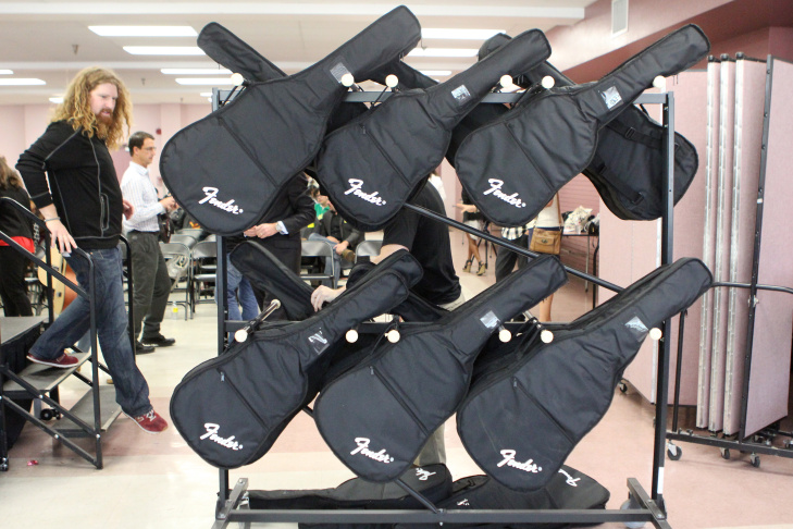 Nate Anderson, Little Kids Rock's West Coast Director, exits the stage at Pio Pico Middle School. The Los Angeles Unified school received 25 acoustic guitars as part of a new funding announcement Wednesday.