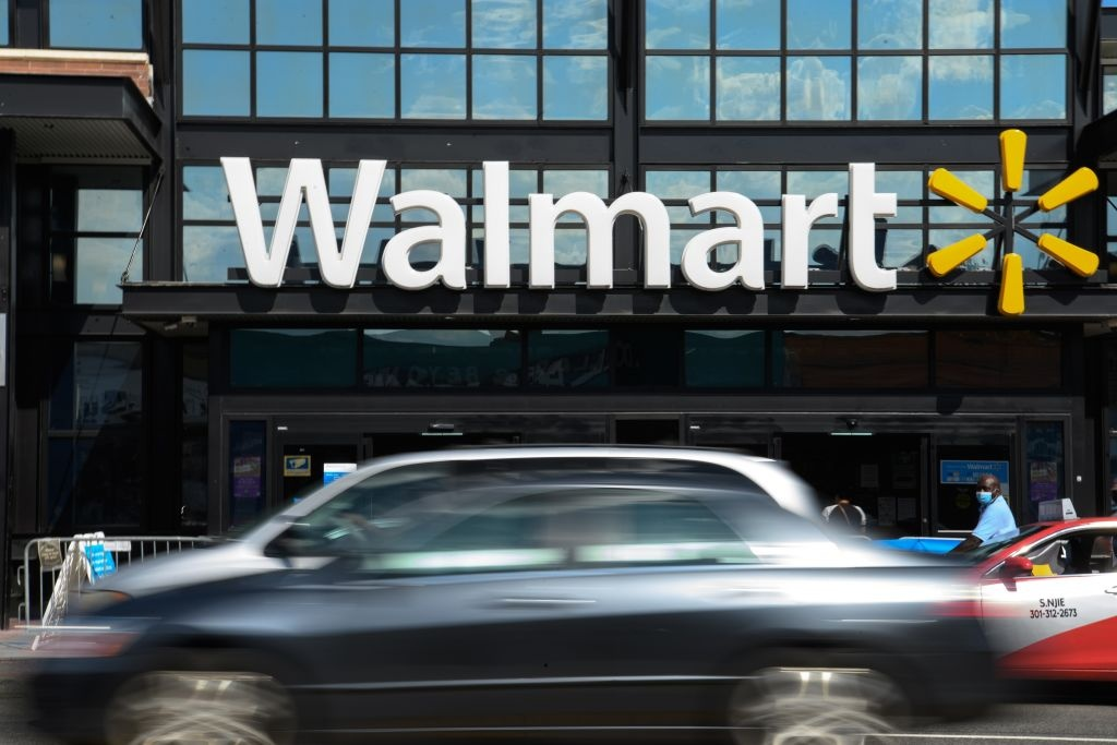 Cars drive past a Walmart store in Washington, DC, on August 18, 2020.