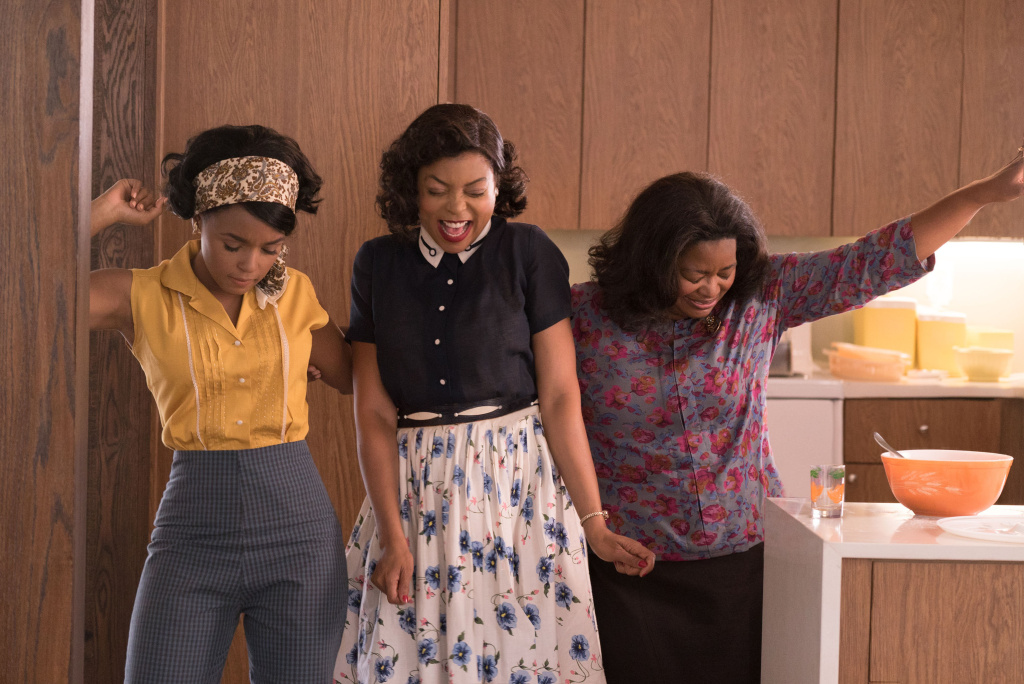 Mary Jackson (Janelle Monae, left), Katherine Johnson (Taraji P. Henson) and Dorothy Vaughan (Octavia Spencer) celebrate their stunning achievements in one of the greatest operations in history.
