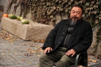Chinese artist Ai Weiwei sits in the courtyard of his home in Beijing where he remains under house arrest on Nov. 7, 2010.