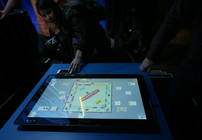 Diego Romeu of 3M Touch Systems uses an 84 inch touch table during a press event at the Mandalay Bay Convention Center for the 2013 International CES on January 6, 2013 in Las Vegas, Nevada.