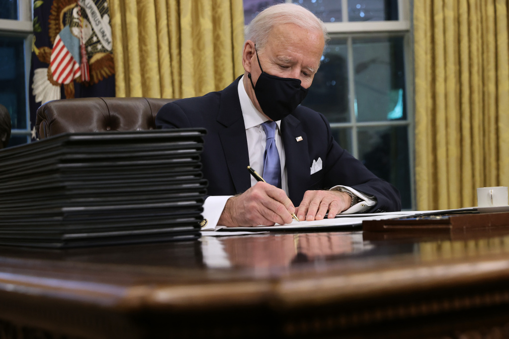 U.S. President Joe Biden prepares to sign a series of executive orders at the Resolute Desk in the Oval Office just hours after his inauguration on January 20, 2021 in Washington, DC.