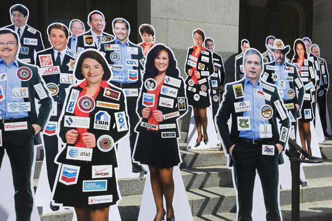 A proposed general election ballot initiative would require state lawmakers to wear their top donors' labels on their clothes in the fashion of NASCAR drivers.
