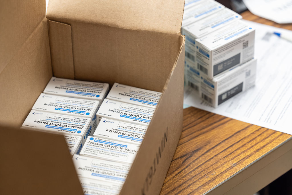 Boxes containing vials of the Janssen COVID-19 vaccine sit in a container before being transported to a refrigeration unit at Louisville Metro Health and Wellness headquarters on March 4, 2021 in Louisville, Kentucky.