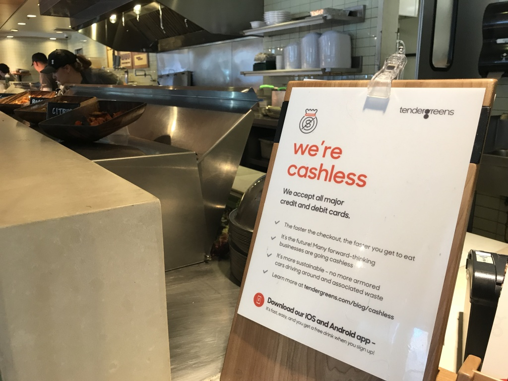 Signs throughout Tender Green's location in Pasadena warn customers not to try to pay with cash once they get to the register, March 28, 2018.