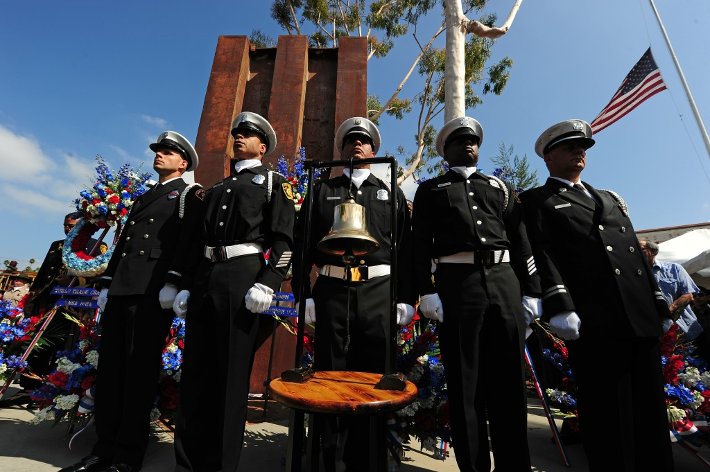 Members of the Los Angeles City Fire Department stand in front a 22-foot steel column that was a part of the lobby of the World Trade Center during an official  9/11 remembrance ceremony for the tenth anniversary of the September 11, 2001 terrorist attacks.