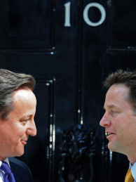 Britain's new Prime Minister David Cameron (L) and new Deputy Prime Minister Nick Clegg, pose for pictures on the steps of 10 Downing Street in London, on May 12, 2010.