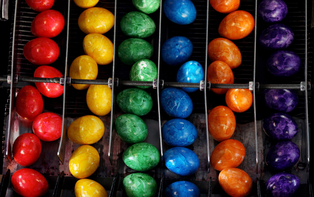 Cooked and coloured Easter eggs on a conveyor belt. What are you up to this holiday weekend?