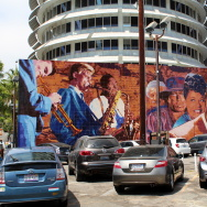 """Hollywood Jazz: 1945-1972,"" also known as the Capitol Records Jazz Mural, on the south wall of the Capitol Records Building, painted by artist Richard Wyatt in 1990. The mural depicts Billie Holiday alongside Chet Baker, Gerry Mulligan, Charlie Parker, Tito Puente, Miles Davis, Ella Fitzgerald, Shelly Manne, Dizzy Gillespie, Duke Ellington and Nat ""King"" Cole."
