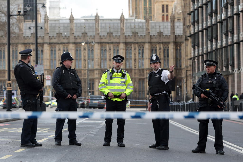 Armed officers attend to the scene outside Westminster Bridge and the Houses of Parliament on March 22, 2017 in London, England.