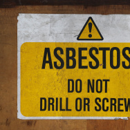 A sign warns of asbestos danger at a former Royal Mail sorting office on October 11, 2013 in London, England.