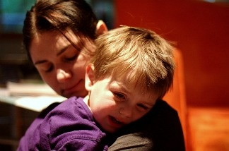 Mother comforts her child.