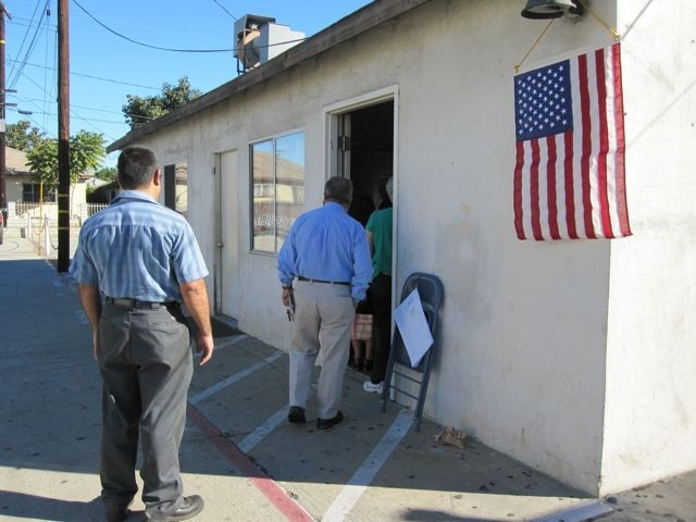 Voters lined up this morning outside a polling place at the Iglesia de Dios church in Bell, Calif.