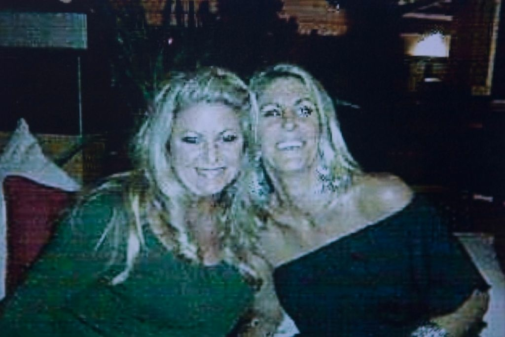 A flier posted outside of the salon shows Michelle Fournier, left, the suspect's ex-wife.