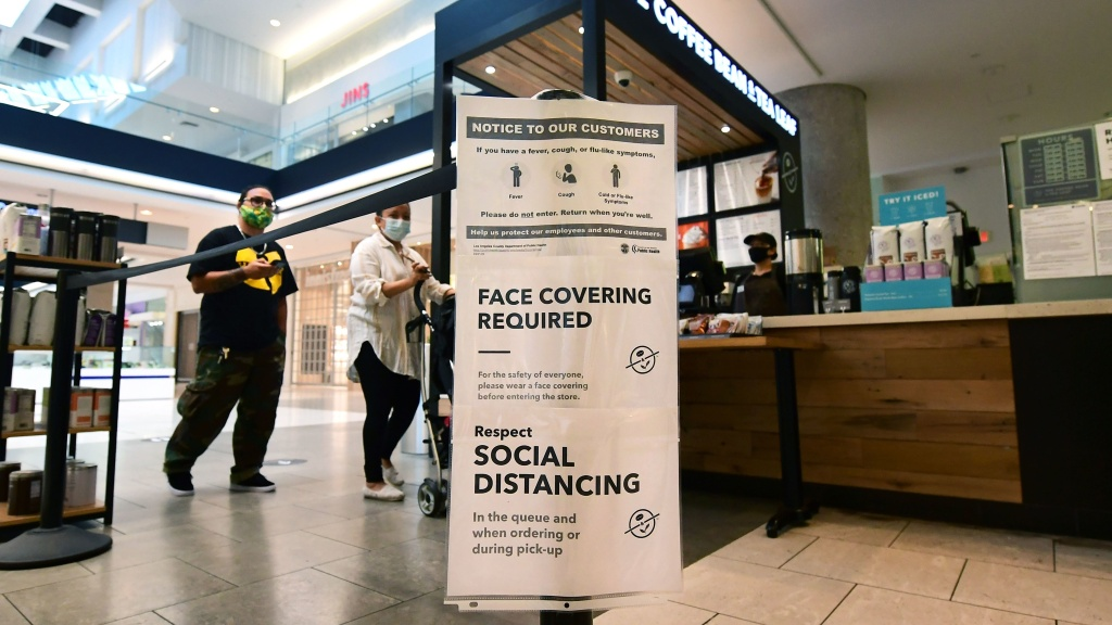Social distancing instructions are seen at California's Westfield Santa Anita shopping mall on June 12, as local businesses enter Phase 3 reopening.