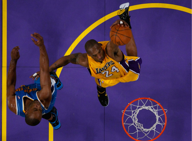 Kobe Bryant #24 of the Los Angeles Lakers dunks the ball with his left hand in the lane in the third quarter against the New Orleans Hornets in Game Five of the Western Conference Quarterfinals in the 2011 NBA Playoffs.
