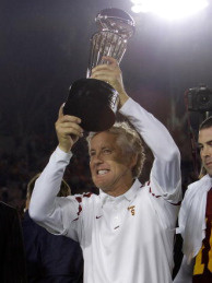 Head Coach Pete Carroll of the USC Trojans holds up the 94th Rose Bowl game winner's trophy after the USC Trojans defeated the Illinois Fighting Illini 49-17 in the Rose Bowl presented by Citi at the Rose Bowl on January 1, 2008 in Pasadena, California.