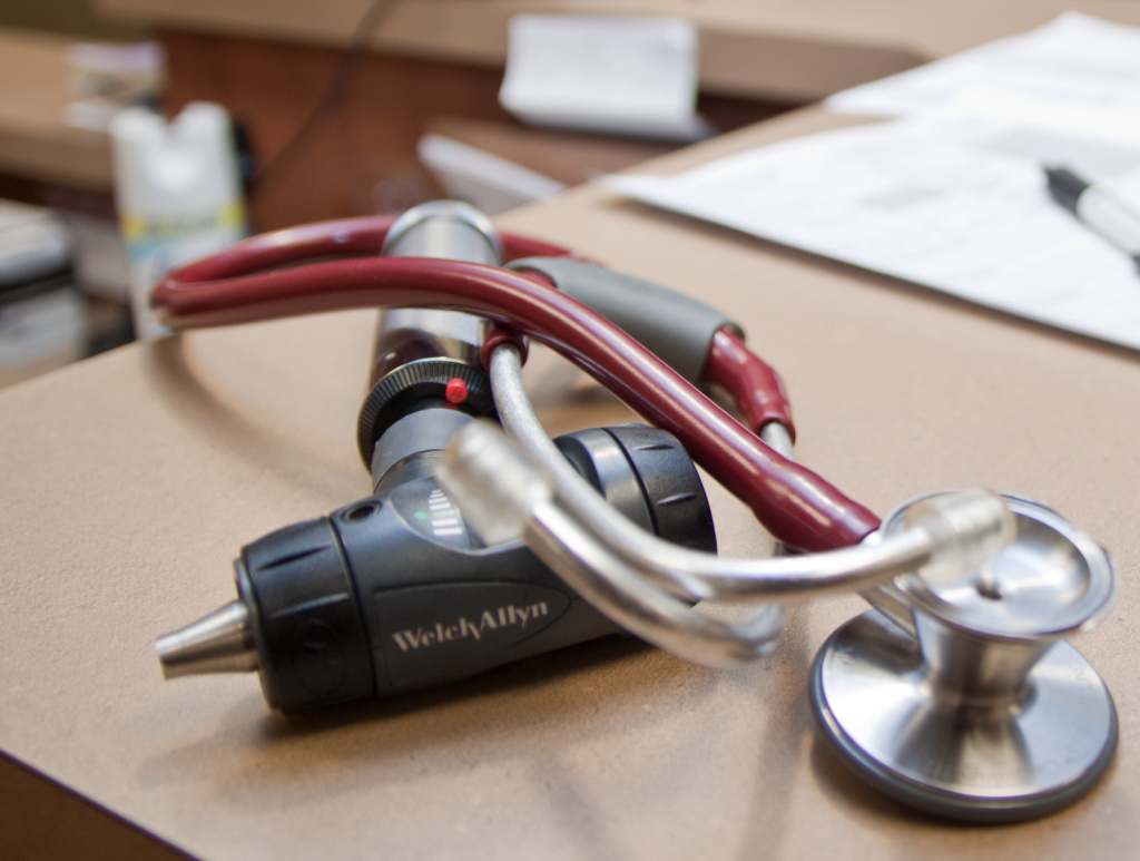 A doctor's stethoscope left on a table.