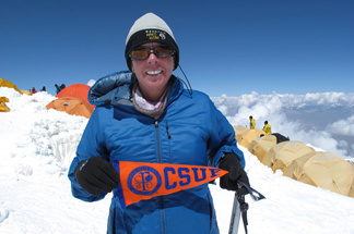 Cindy L. Abbott, a proud Titan, sports a Cal State Fullerton banner at Peak Lenin in Kyrgyzstan.