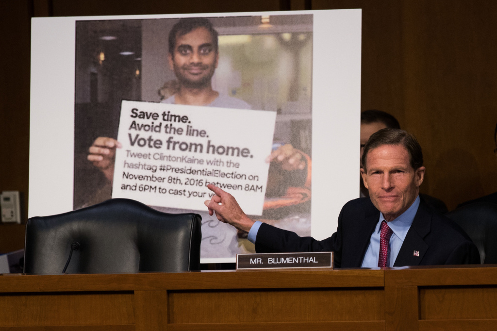 With a Twitter post encouraging voters to vote from home displayed behind him, Sen. Richard Blumenthal, D-Conn. questions witnesses during an October 2017 Senate hearing on Russian disinformation during the 2016 campaign.
