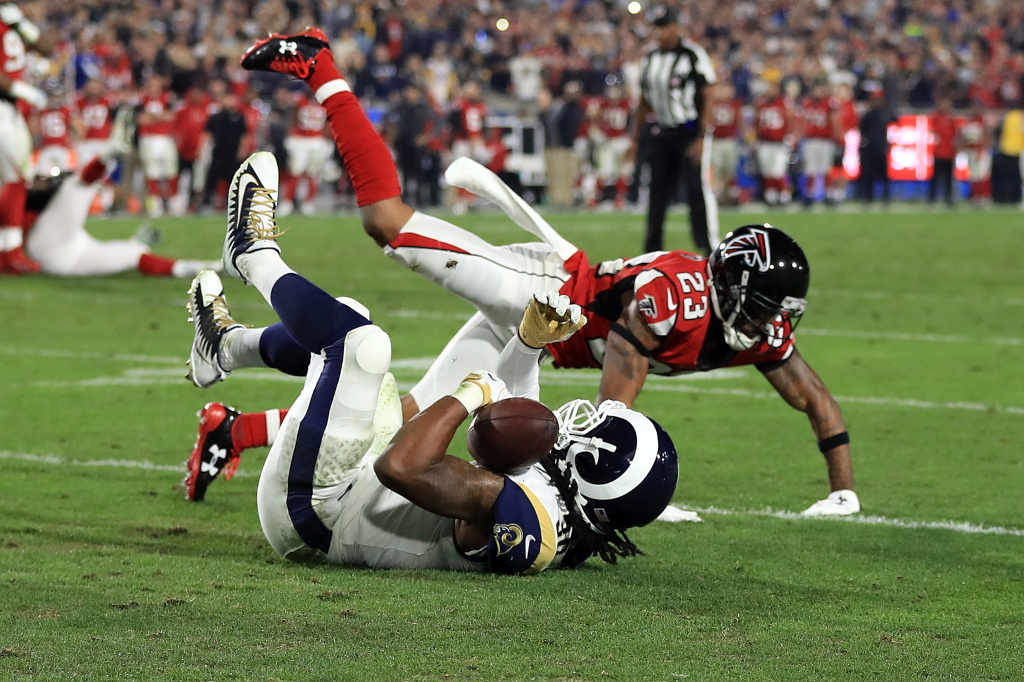 LOS ANGELES, CA - JANUARY 06:  Todd Gurley #30 of the Los Angeles Rams fails to complete a catch during first half of the NFC Wild Card Playoff Game against the Atlanta Falcons at the Los Angeles Coliseum on January 6, 2018 in Los Angeles, California.  (Photo by Sean M. Haffey/Getty Images)