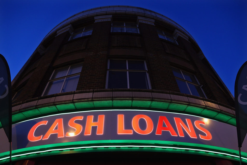 A general view of a 'Speedy Cash' cash loans shop on Brixton High Street on November 1, 2012 in London, England. The recession has changed the face of the UK's high streets, which have seen a boom in bookmakers, discount stores, charity shops, cheque cashing (payday loans) and pawnbrokers as cash-strapped Brits struggled with their finances.