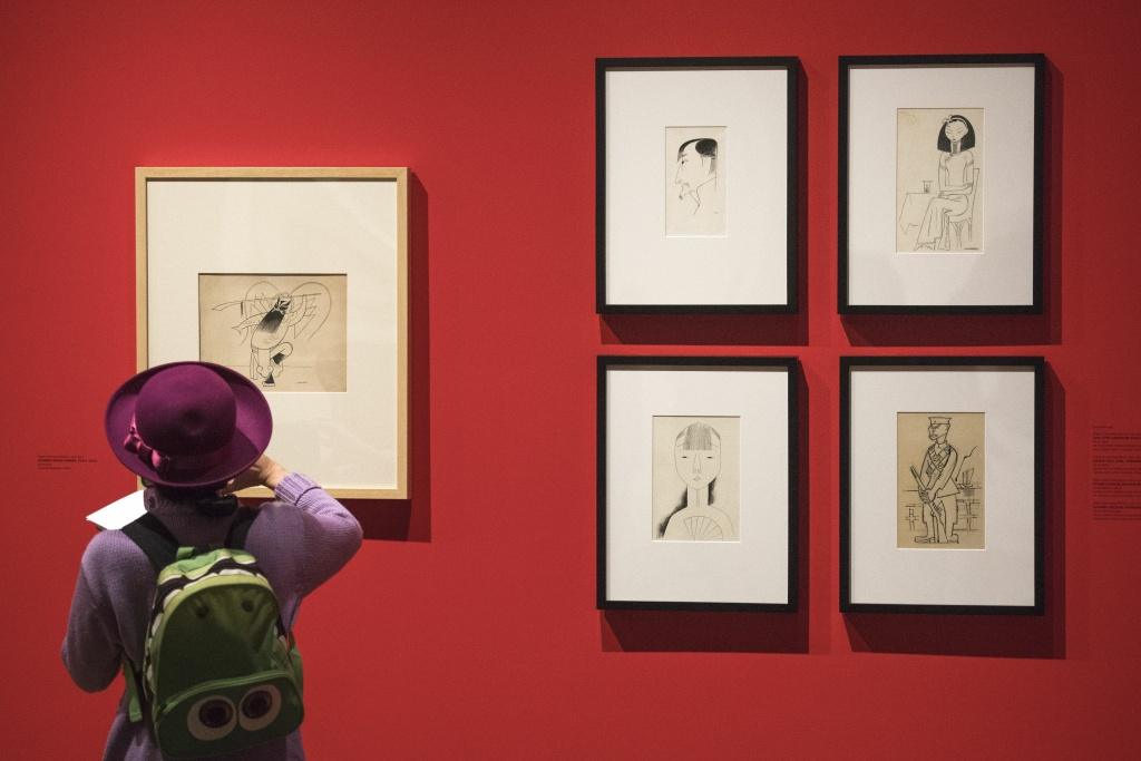 A visitor examines work by Mexican artist Miguel Covarrubias, part of the