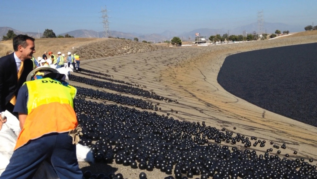 Los Angeles Mayor Eric Garcetti helps to release shade balls into the L.A. Reservoir.