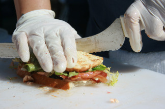 A worker prepares a sandwich at Monsieur Egg.