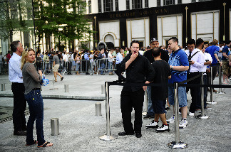 Apple fans wait in line to become the first owners of the latest-generation iPhone, called the iPhone4, as it made its global debut in five countries, June 24, 2010 in New York.