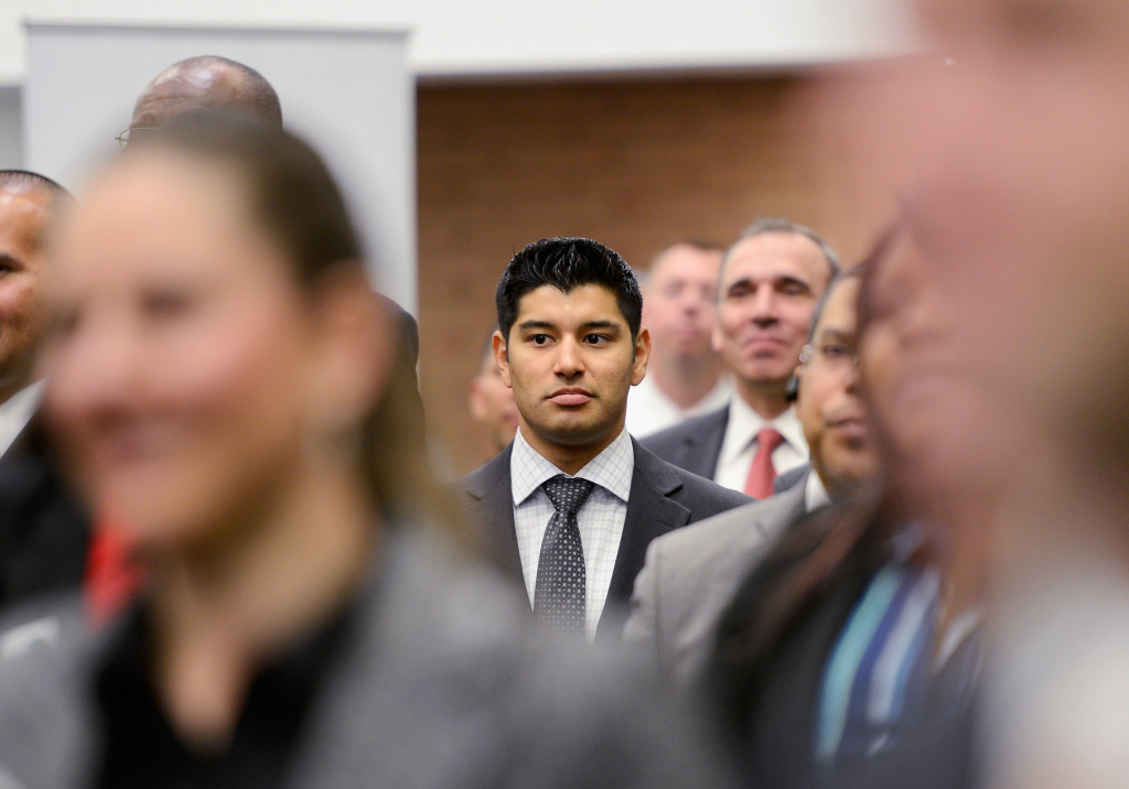 In this file photo, veterans listen to a speaker as they look for job openings at the University of Southern California booth during a jobs fair for veterans called