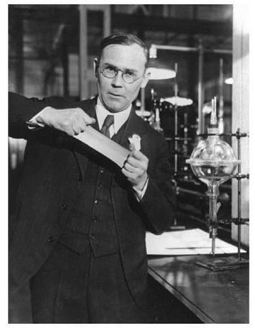 Wallace Hume Carothers demonstrating the elastic properties of neoprene.
