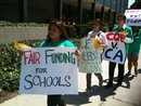 Students rally in Long Beach in support of a lawsuit to improve funding for public schools.