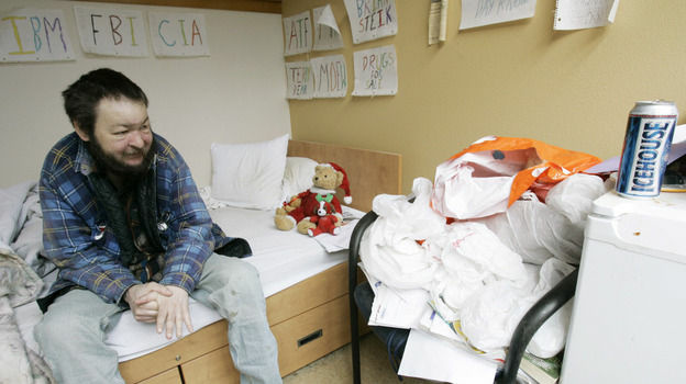Brian Steik sits in his cubicle at an apartment building for homeless alcoholics in Seattle.