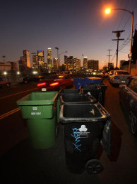 Emptied trash cans stand in the street in Los Angeles, California. City Controller Wendy Greuel warns that the city could run out of money as soon as May 5. Would it cause an immediate shutdown of basic services?