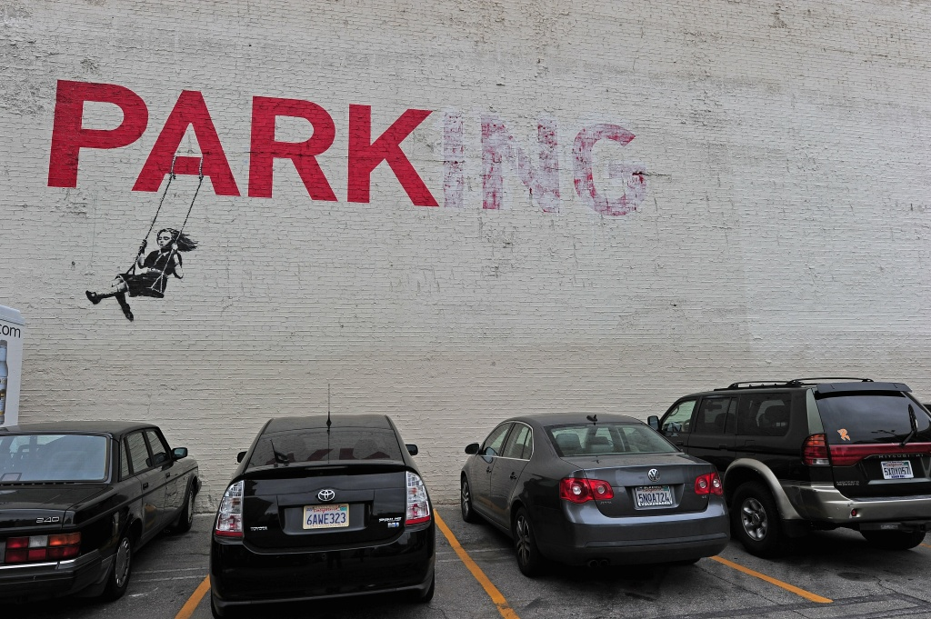 Street graffiti art is seen on a wall in a parking lot in downtown Los Angeles, May 1, 2012.