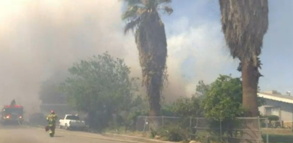 The eight-acre blaze was contained Thursday evening, but not before destroying one home.