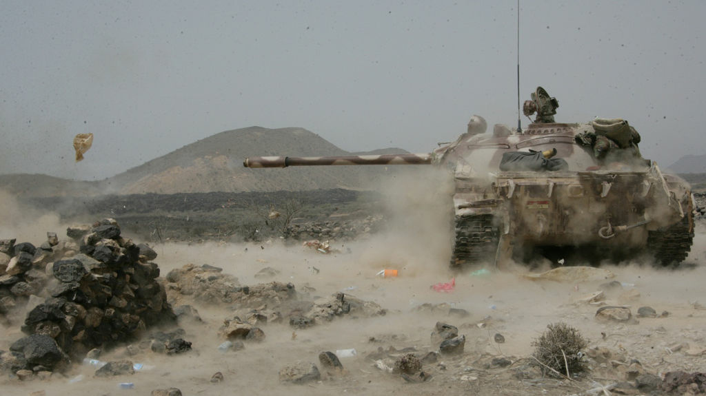 Yemen's army says it has pushed al-Qaida fighters out of towns in the south. Here, a Yemeni army tank fires at positions of al-Qaida militants near the coastal town of Shaqra, Yemen, June 13, in a photo provided by Yemen's Defense Ministry.